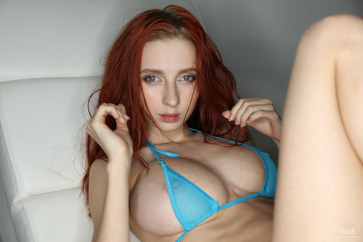Busty skinny redheaded Helga Grey bares her huge boobs and